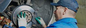 mechanic repairing a disk brake
