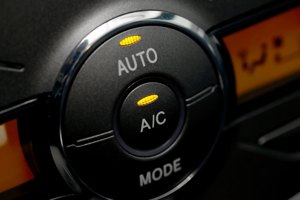 image of a close up of an air conditioning button in a car