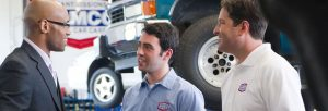 image of AAMCO mechanic manager and happy customer talking