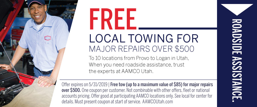 image - coupon for a vehicle tow with a man standing next to car